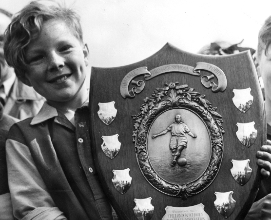 Bobby Moore holding the Crisp Shield in 1951