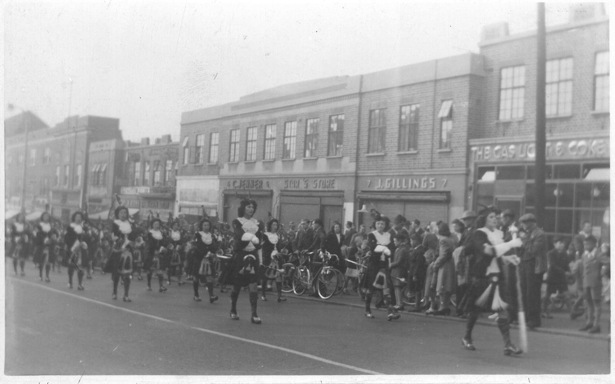 Girl Pipers march on Dagenham Heathway in 1948