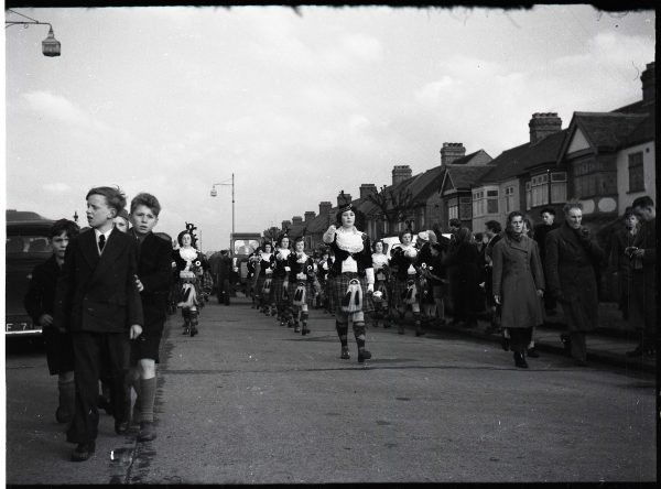 The Dagenham Girl Pipers march from Romford to Central Park, Dagenham