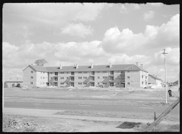 large block of flats on Eastern Avenue in 1955, with the A12 in the foreground