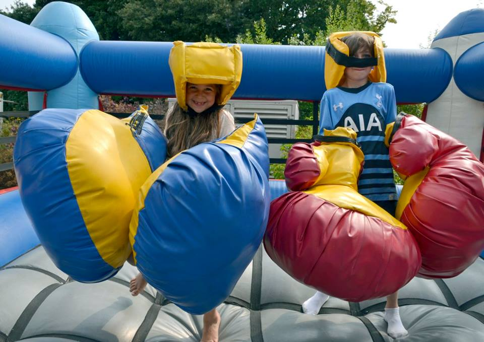 Children on the bouncy boxing inflatable game