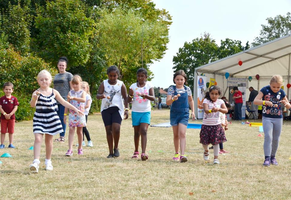 Children taking part in the egg and spoon race
