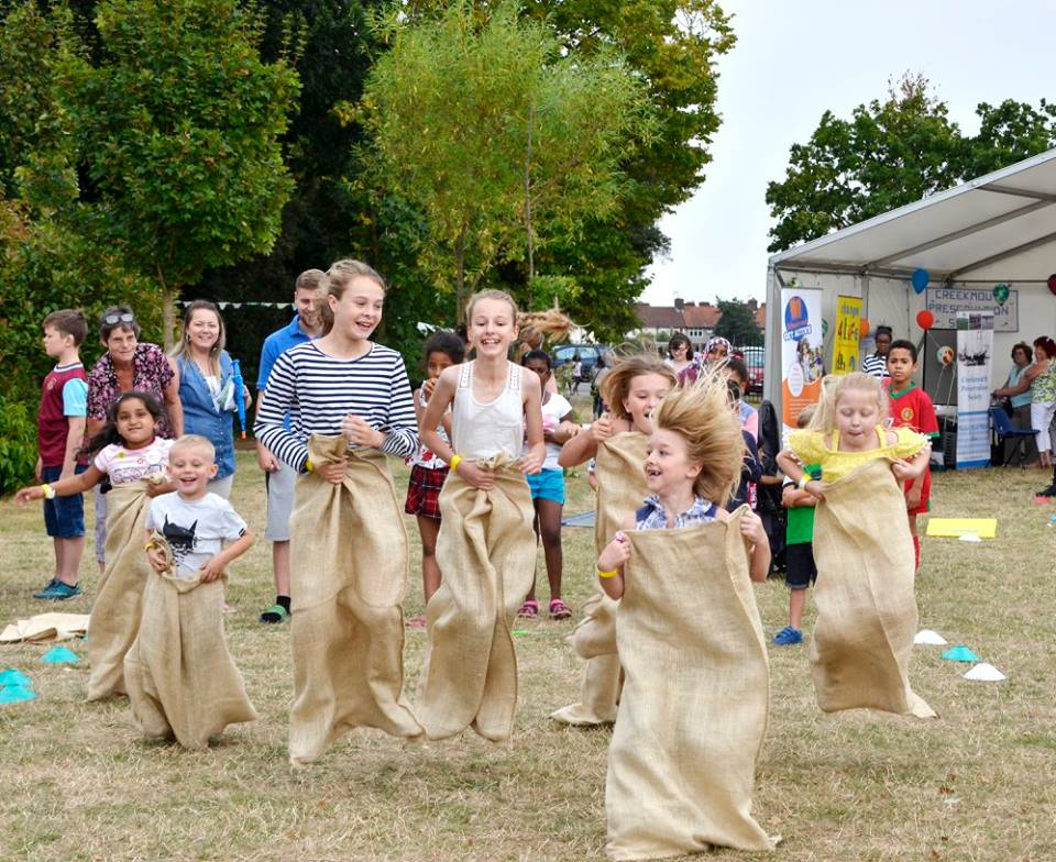 Children taking part in the sack race